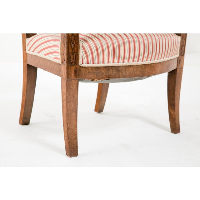 A great classic pair of early 19th century Italian Empire walnut arm chairs made about 1820. These have nice color and a...