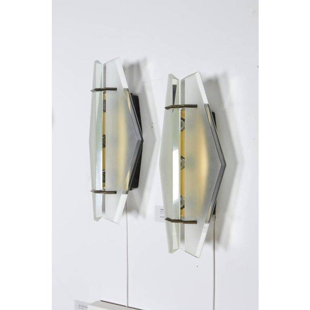 Wonderful pair of bevel cut and frosted glass sconces that have been rewired with american candelabra sockets.