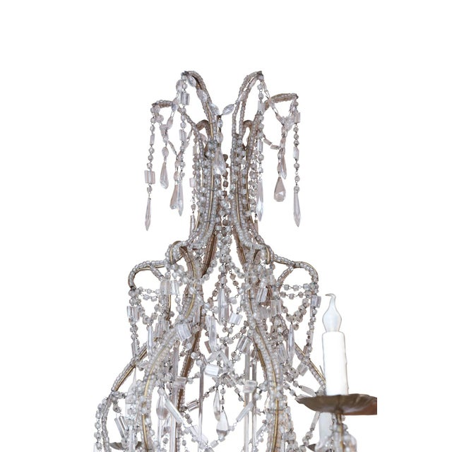 Italian crystal beaded chandelier: beaded gilt-iron frame with six arms decorated in crystal and glass pendants and...