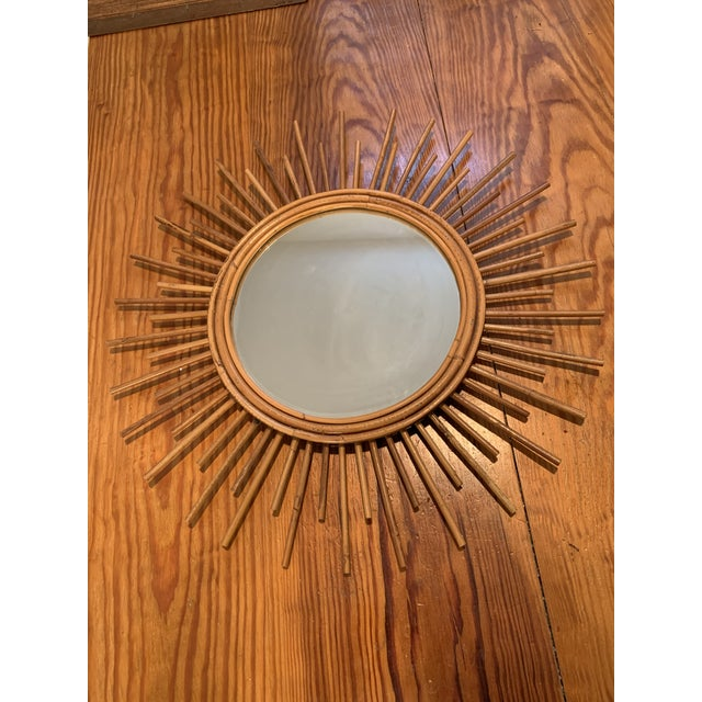 1960's French sunburst rattan mirror with two length alternating rays. Unusual style.