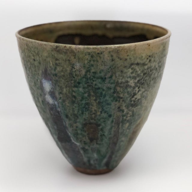 This striking studio pottery vase feels is as much a sculptural object as a functional vessel. With gorgeous painterly...