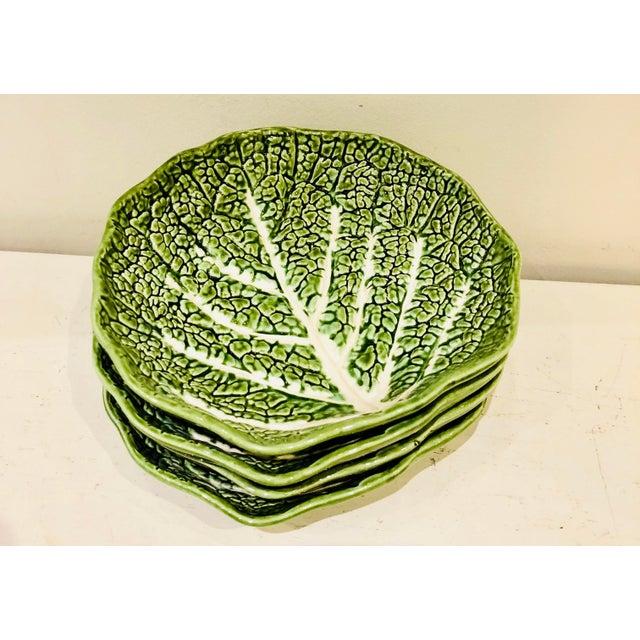 Set of four vintage Portuguese Majolica lettuce leaf salad or dessert bowls. No marks.