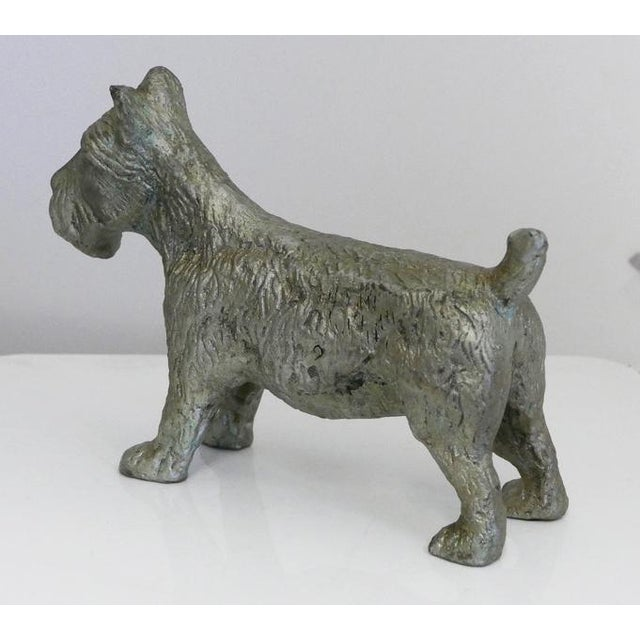 Cast Iron Vintage Scottish Terrier. It could be used as a doorstop or just a figurine to commemorate your puppy.