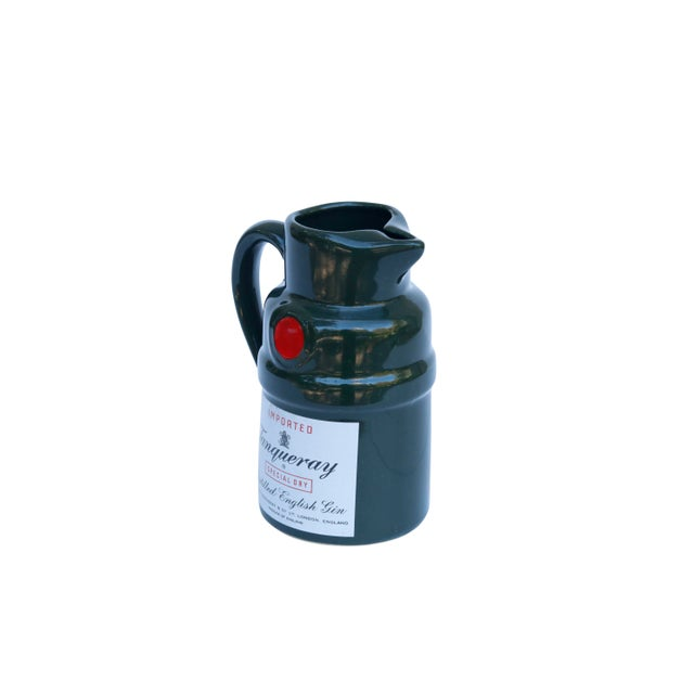 A forest green pitcher for Tanqueray Distilled English Gin. Curvaceous with a red dot to give the look of a wax seal. On...