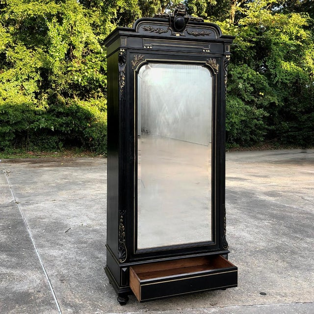 19th Century French Napoleon III Ebonized Armoire was considered the essence of elegance during the reign of the last...