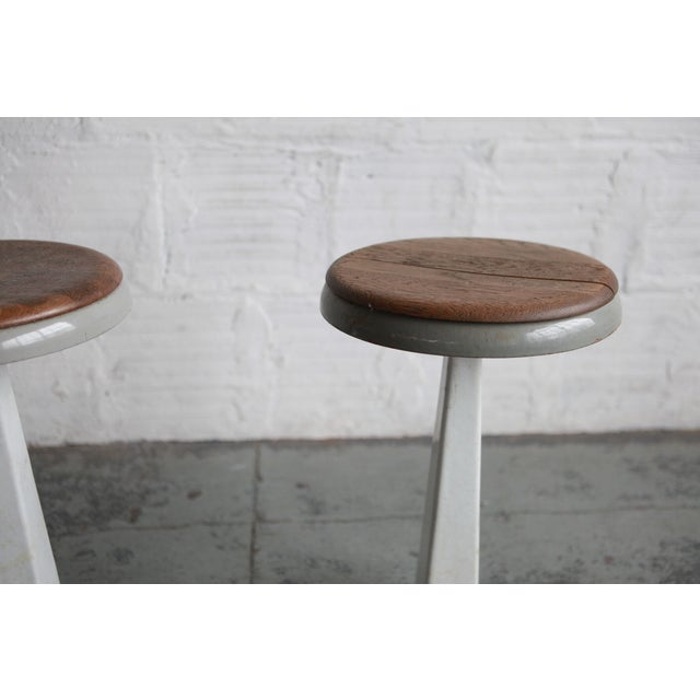 These stools have a minimalist mid-century modern form and tonality. They are made with industrial materials. Their age is...