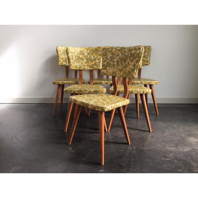 Vintage mid century modern dining set with 6 armless chairs + expandable table. From the atomic lines to the green &...