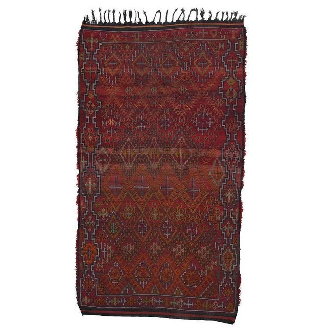 An amazing Moroccan Berber carpet from the Middle Atlas Mountains. The very dense and well-preserved pile hides a complex...