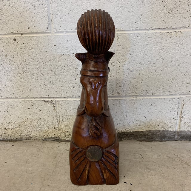 Really unusual Sarreid piece. Solid block of wood carved into a horse head with carnival plume on its head. Brass or metal...