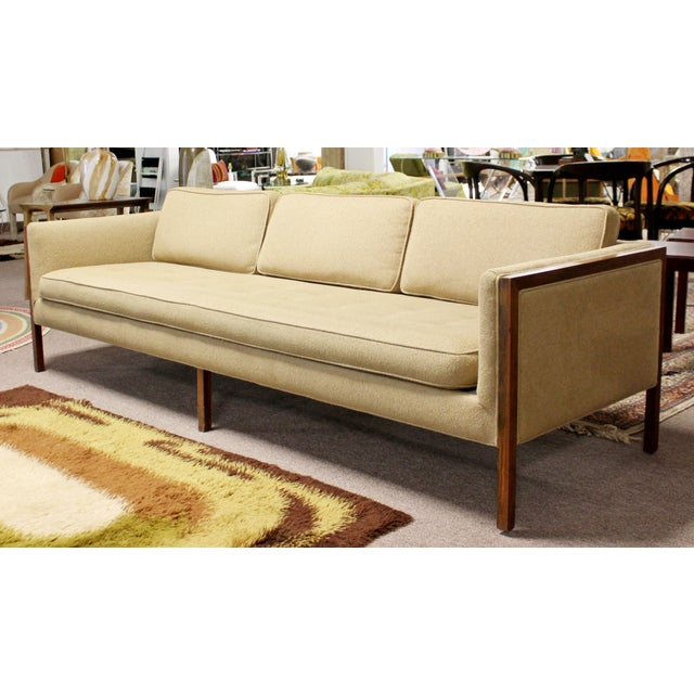 For your consideration is a gorgeous sofa, on a wood base, in the style of Harvey Probber or Florence Knoll, circa the...