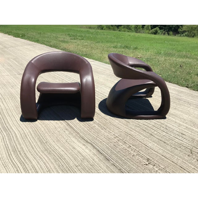 Pair of sculptural ribbon cantilever chairs, Louis Durot style, leather, steel frame, Canada, 1990s.