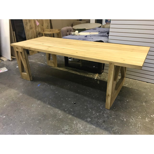 Great 8' x 3' dining table - legs are notched into the top. Legs are also different on each end. Oak is nicely finished...
