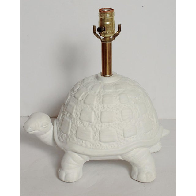Wonderfully whimsical decorative table lamp in the shape of a curious white plaster turtle. Great for a kids room or any...