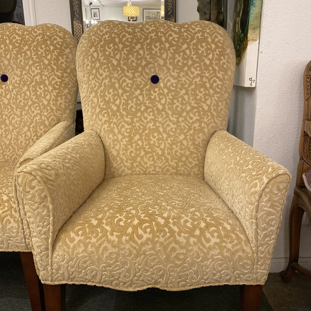 Design Plus Gallery presents a pair of Decorators Walk Chairs by John Oetgen Collection. Custom fabric consists of a cut...