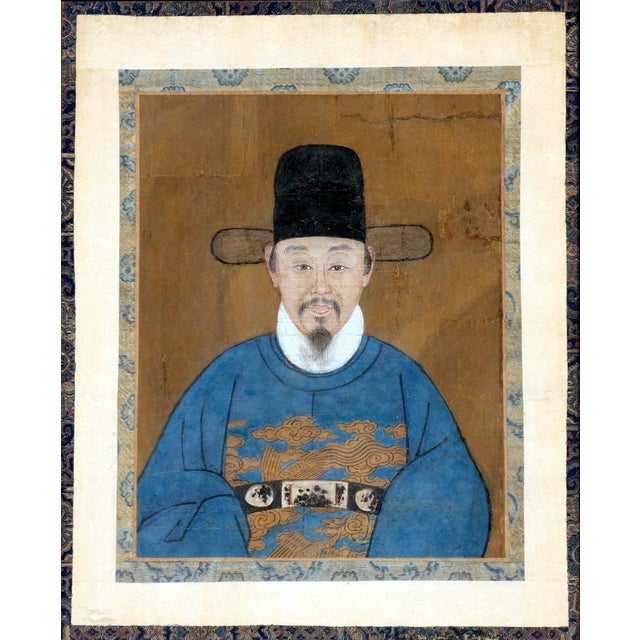 A hyper realistic portrait of an official with watercolor on silk bordered panel, framed in dark wood, from Korean late...