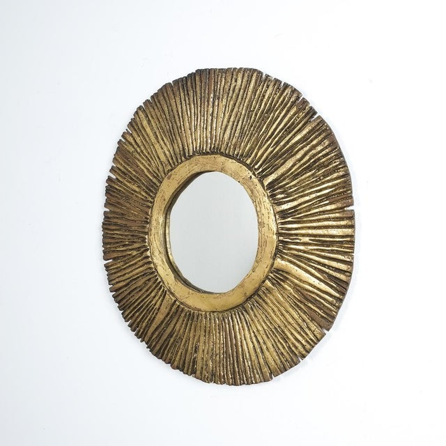 Impressive solid brass mirror, in the style of Curtis Jere, circa 1955 featuring a handmade heavy and solid cast brass...