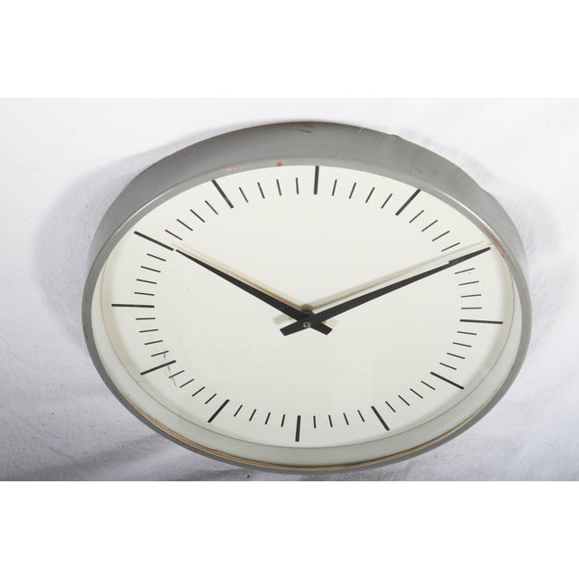 LM Ericsson. Electric metal wall clock, vaulted dial glass, rebuild to battery movement. Sweden, 1960s. Ø 34 cm. Very good...