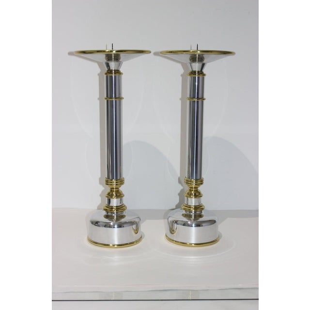 This stylish, large scale pair of candlesticks dates to the 1970s and they have been professionally polished and lacquered.