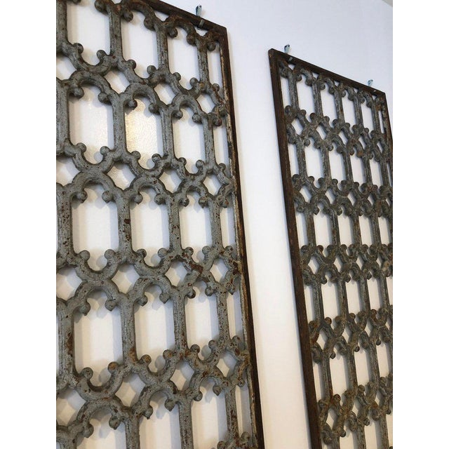 Pair of iron grids with scroll pattern, possible from a gate or window panel. Pretty blue or grey color with patina. They...