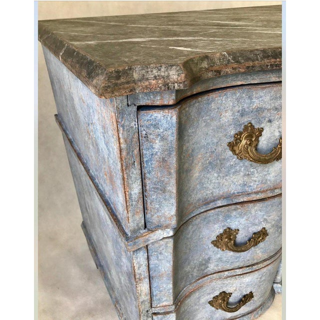 This three-drawer Swedish Baroque chest is a gorgeous saturated blue color with a black faux marble top in great...