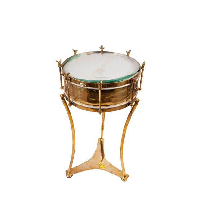 Solid brass military or marching band snare drum complete with drum heads in working order (possibly replaced in the last...