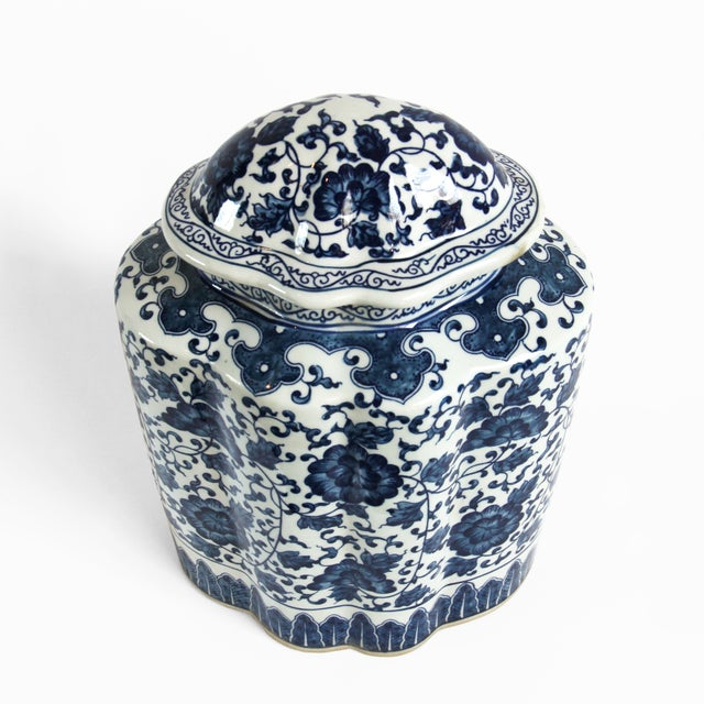 Blue and white porcelain ginger jar with lid. This jar has a beautiful shape and a traditional floral design pattern.