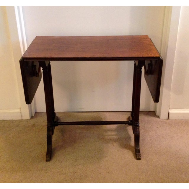 Up for sale a vintage John Wanamaker New York Regency style burl walnut coffee table. The table stands on 4 reeded columns...
