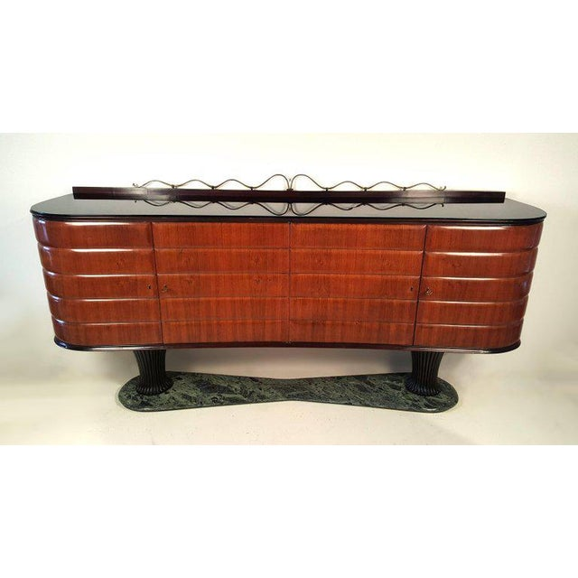 A phenomenal early Italian modernist server in sculpted Italian walnut with hand-carved mahogany bases, black milk glass...