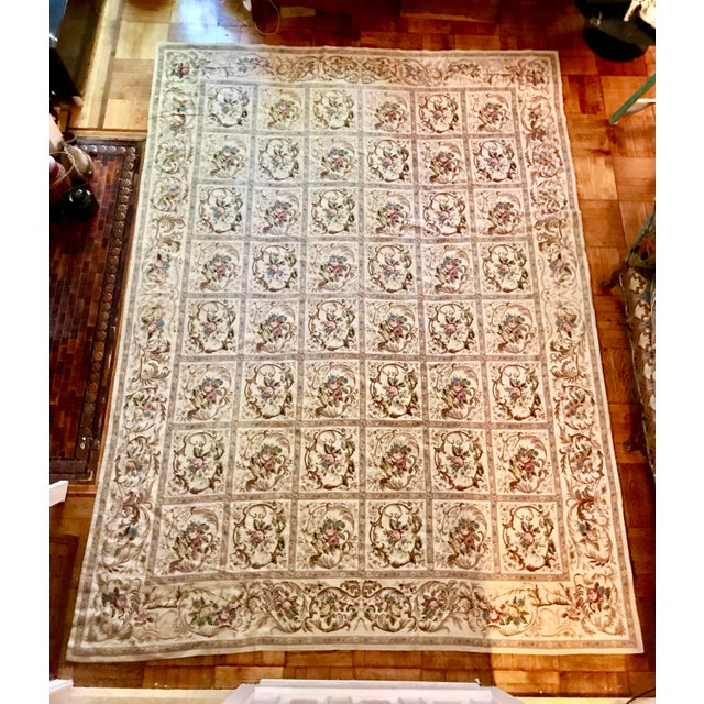 Beautiful very large French Aubusson needlepoint rug in repetitive rose square pattern. As in the aubusson style the...