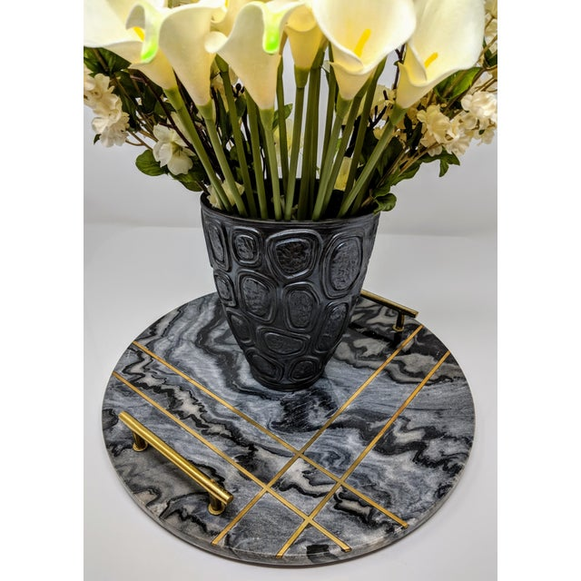 This beautiful marble tray with polished brass handles is a bit of organic modern mixed with classic minimalist modern....