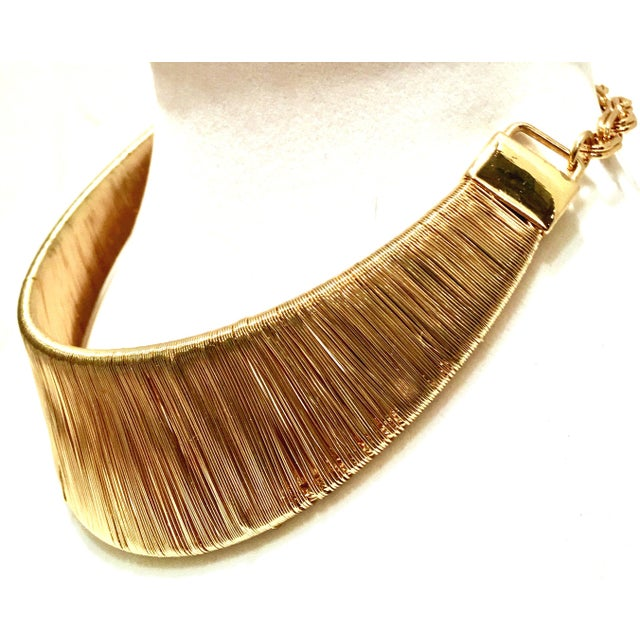 1980'S Gold Plate Curved Woven Wire Collar Choker Style Necklace. Attributed to Napier. This shimmering piece features a...