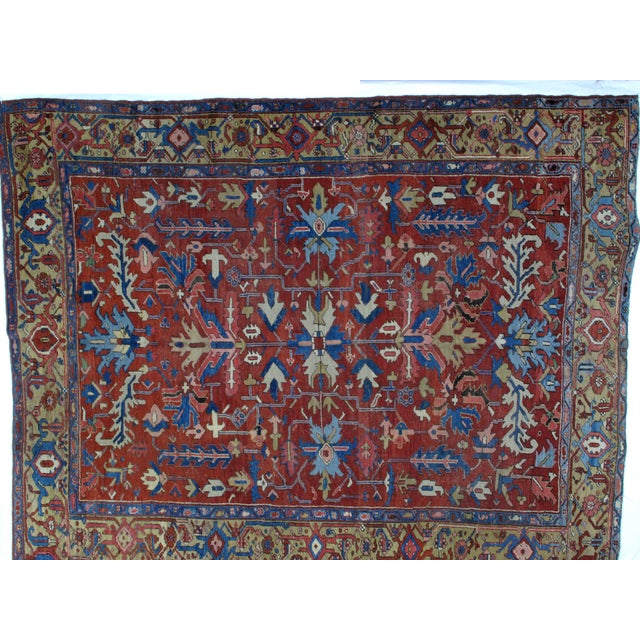 This master piece is a wool pile genuine hand woven antique Persian Serapi carpet located at North west of Persia. In...