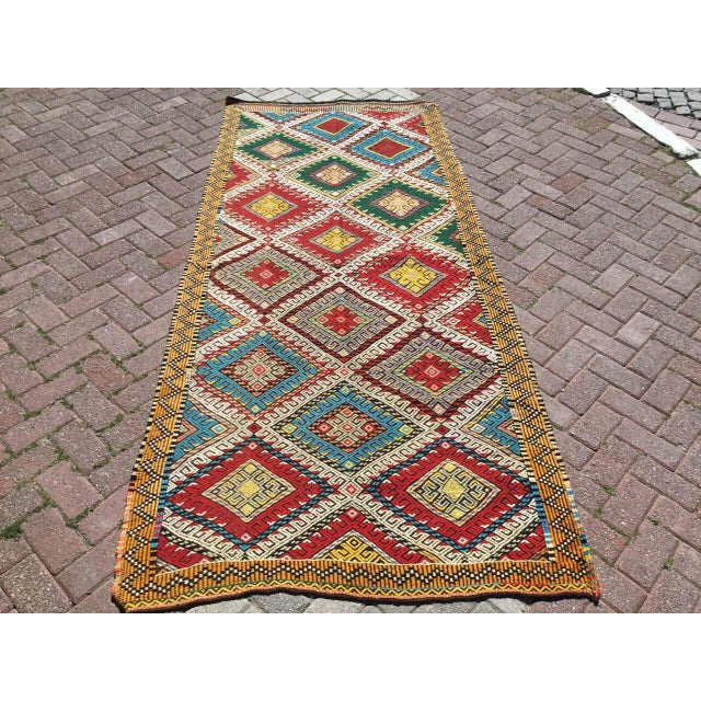 This beautiful vintage handwoven kilim in fabulous shape. It is approximately 60 years old, handmade of very fine quality...