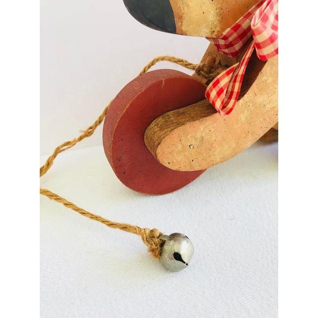 Vintage Primitive Wood Teddy Bear on Rolling Wheels For Sale - Image 9 of 11