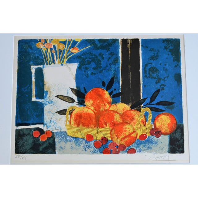 This is an original, hand lithographed, still life table scene with fruit by listed french artist Yves Ganne with a...