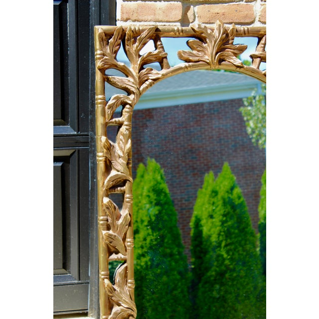 Gorgeous carved leaves framed in bamboo makes this a perfect Hollywood Regency staple. Gold on wood, very glam. Would work...