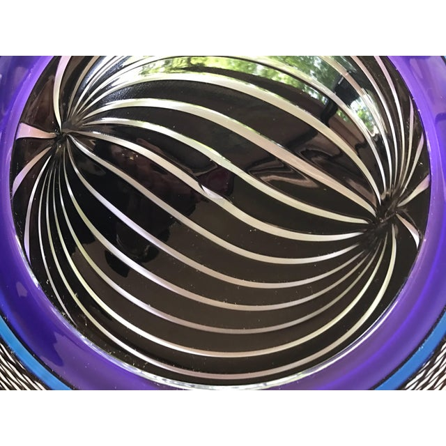 Gorgeous colors adorn this art glass plate done in a stunning purple color scheme.