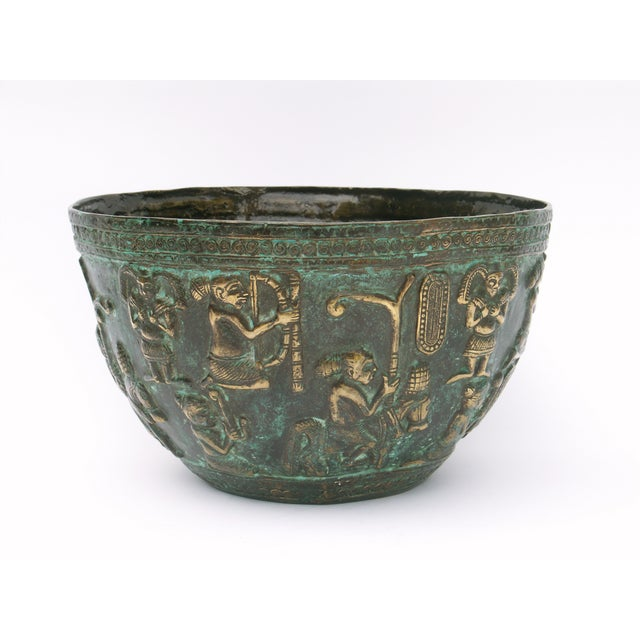 This heavy bronze bowl depicts an ancient Balinese design. It was handmade by skilled craftsmen in Java, Indonesia, using...