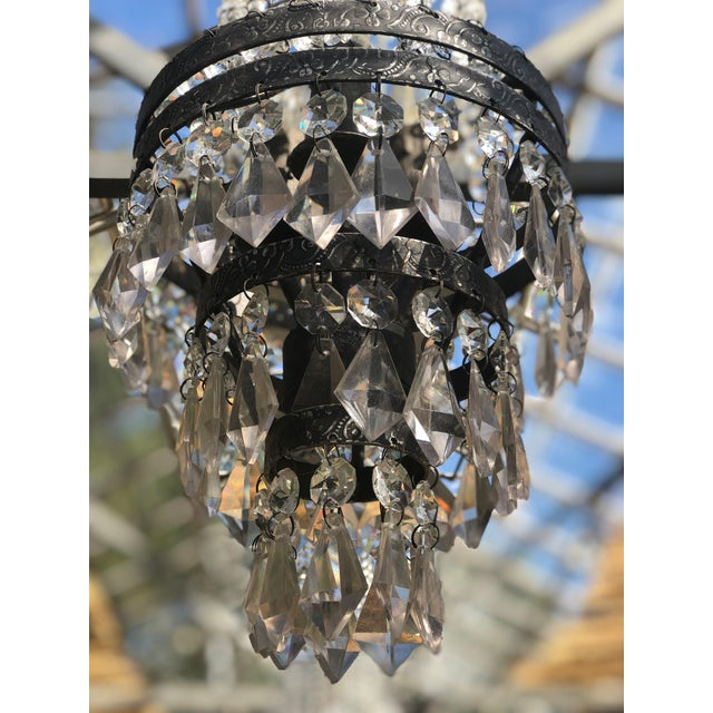 Bring elegance and glamour to any room with this gorgeous Chandelier. Crystal pendants are suspended from a stunning...
