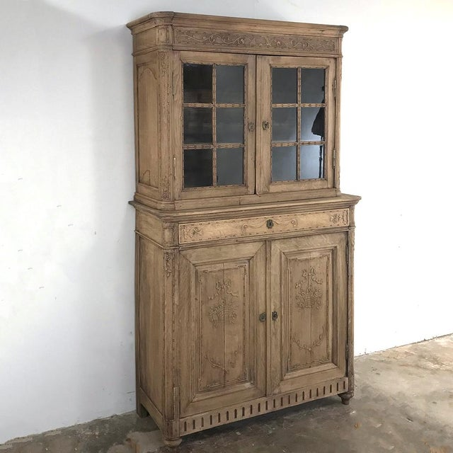 19th Century Country French Louis XVI Stripped Vitrine - Cabinet is the ideal choice for a smaller space, providing...