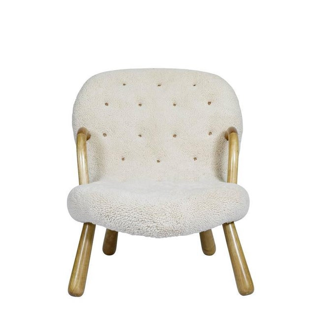 """Philip Arctander """"CLAM"""" chair covered in sheepskin. Store formerly known as ARTFUL DODGER INC"""