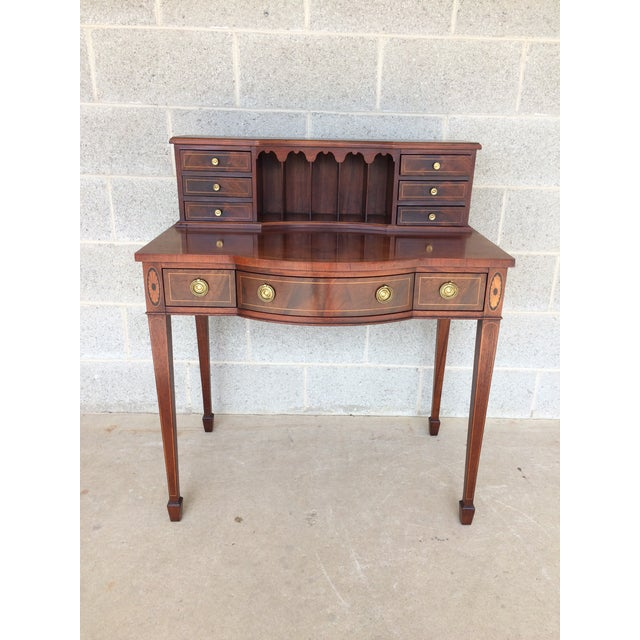 Baker furniture mahogany desk. High quality craftsmanship. In very good condition, clean finish, normal age wear. Features...