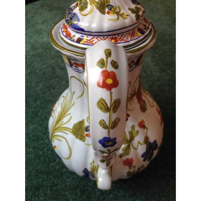 """A beautiful Italian """"Blue Carnation"""" faience coffee pot decorated with red, dark blue, and yellow flowers with greenery on..."""