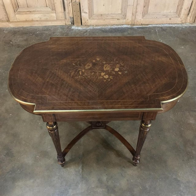 19th Century French Louis XVI Rosewood Inlaid Desk - Writing Table was crafted from the exotic imported wood that was...