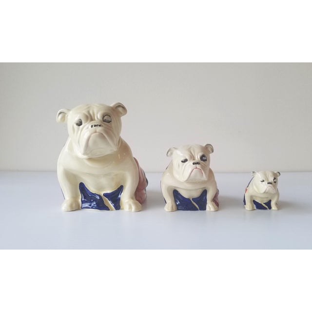 A complete set of the rare Royal Doulton's 1941 Winston Churchill English Bulldogs designed by Charles Noke. A symbol of...