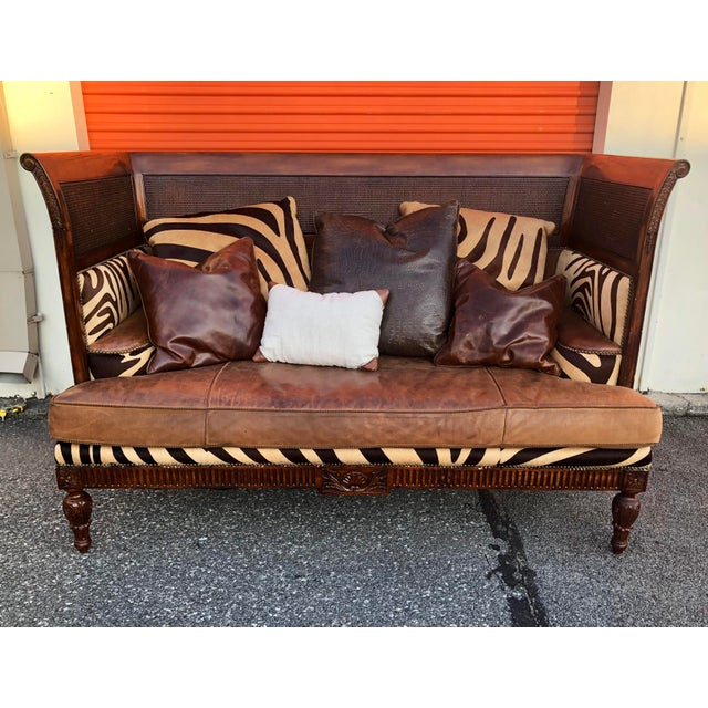 This Maitland Smith Sofa and ottoman are heirloom pieces. Maitland-Smith designs and produces a limited number of pieces...