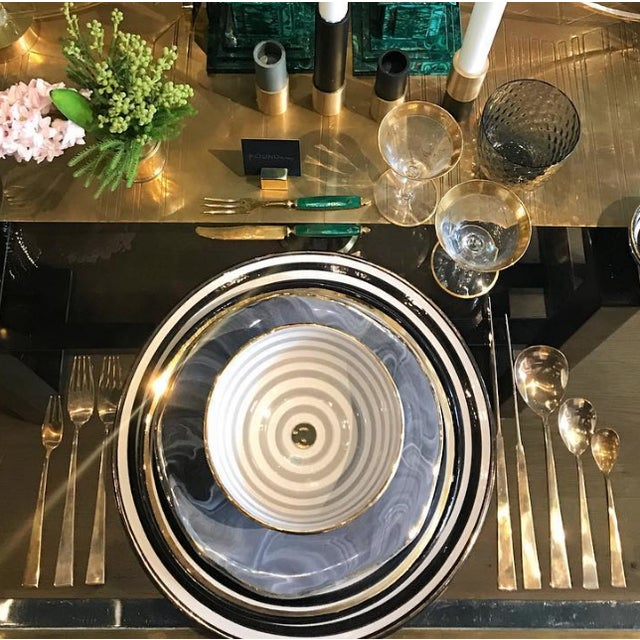 The modern lines of this vintage solid brass flatware set borders on the sculptural and looks equally chic with...