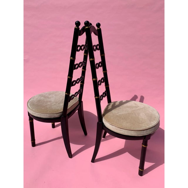 Set of four black and gold lacquered wood chairs with ivory velvet seats. Made by Drexel Heritage. Whimsical and very mid...