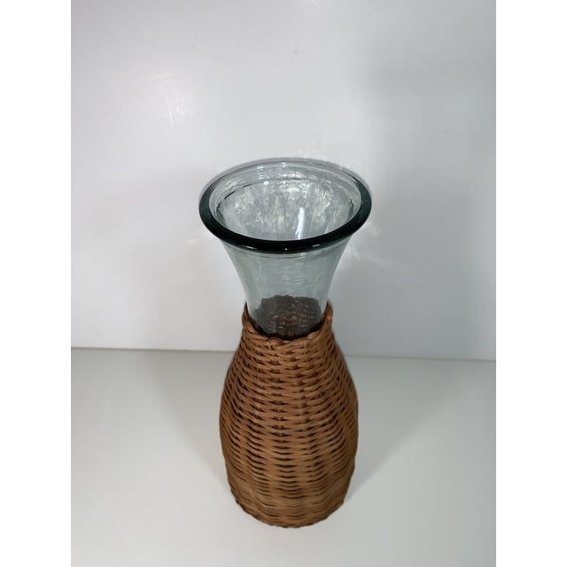 This is a vintage wicker wrapped wine carafe or decanter. The glass is beautiful it has a slight dark tint to it. The...