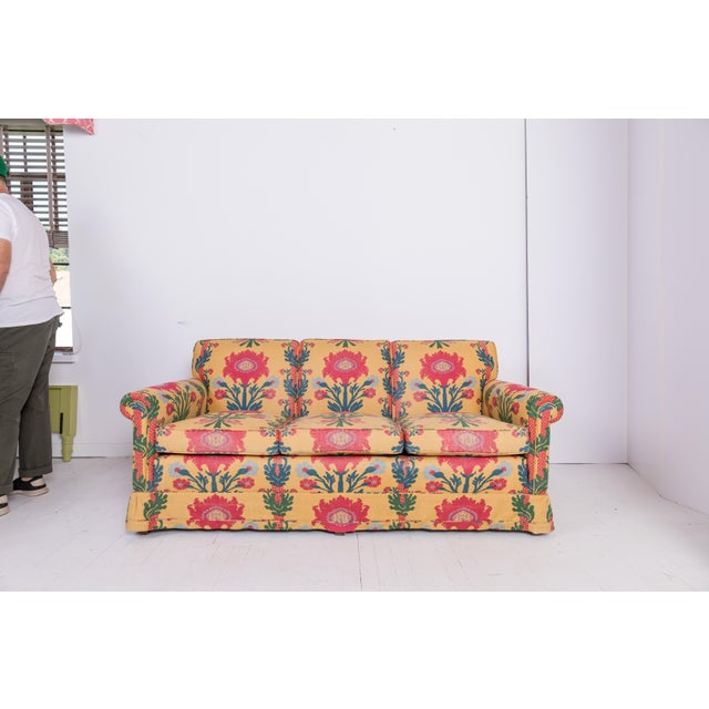 A vintage Madcap Cottage 3-cushion sofa custom-upholstered in a jaunty vintage yellow, red, green, and blue Turkish-...